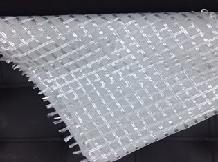 Warp knitted composite geotextile